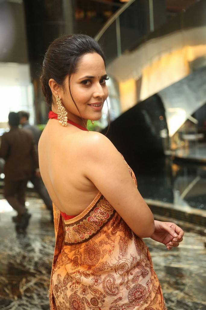 Telugu actress anasuya hot photos in sleeveless orange saree tv anasuya in orange saree telugu actress anasuya hot photos in sleeveless thecheapjerseys Images
