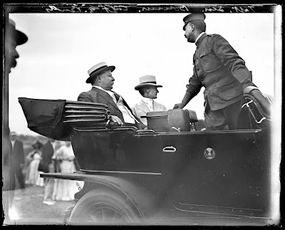 View of President William Taft, Senator Bourne and Archie Butt in a car.