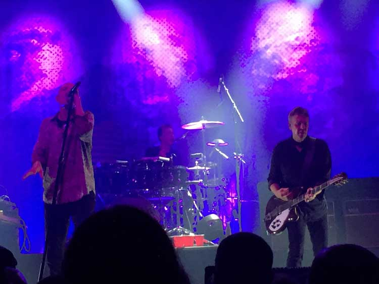 Peter Garrett, Rob Hirst, and Martin Rotsey of Midnight Oil perform live in New York City.