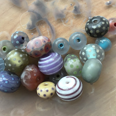 Lampwork glass beads after tumble-etching