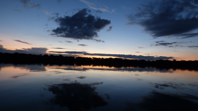 Reflections of the Shire River against the Malawi sky
