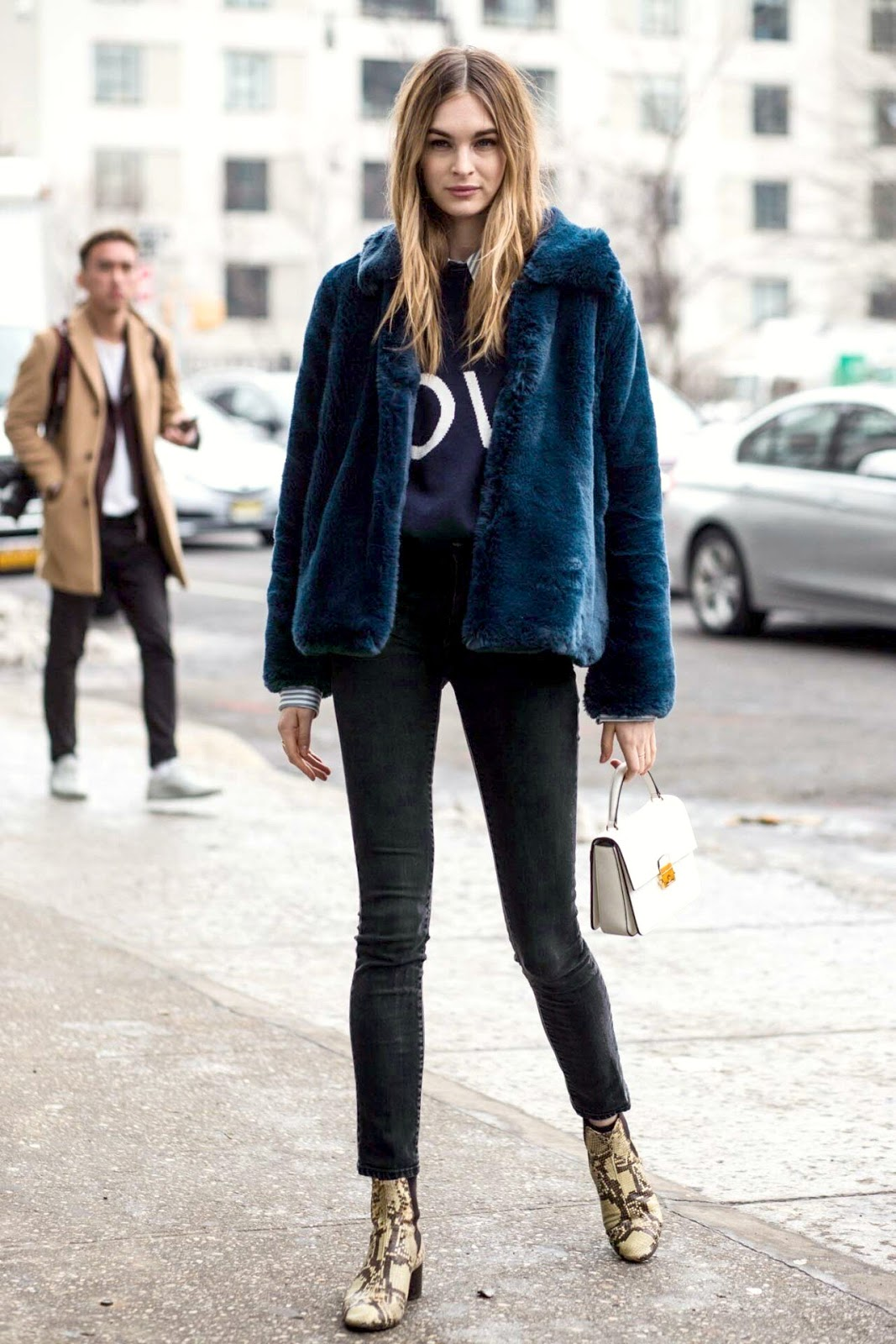 Winter Style — Model in Blue Faux Fur Coat, Graphic Sweater, Black Jeans, and Snake-Print Ankle Boots