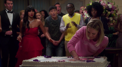 Larry, Tahani, Jason, Chidi, and Simone look on, aghast, as Eleanor drives her hand into a large sheet cake