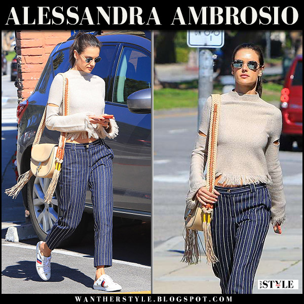 Alessandra Ambrosio in cream cropped sweater, blue pinstripe pants model street style march 29