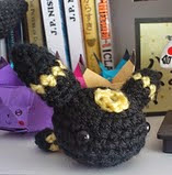 http://www.ravelry.com/patterns/library/tiny-umbreon