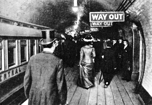 Vintage photo. Early London underground. Edwardian crowd follow Way Out signs. Deadly Dullness, A Word to Women by Mrs. C. E. Humphry, 1898. marchmatron.com