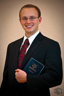Professional portrait of a male LDS missionary holding a Book of Mormon photographed in Pocatello, Bannock, Idaho by Cramer Imaging