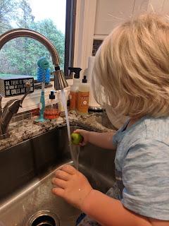 Max washing apples