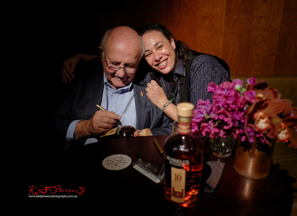 Master distiller Jimmy Russell signs a Russell's Reserve 10 Year Bourbon for Fiona at Grain Bar Sydney. Photography by Kent Johnson.