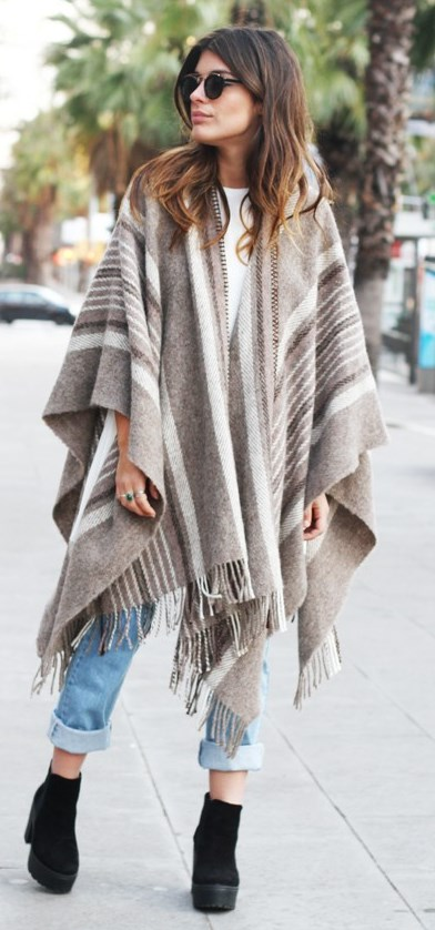 what to wear with a stripped poncho : boyfriend jeans + boots