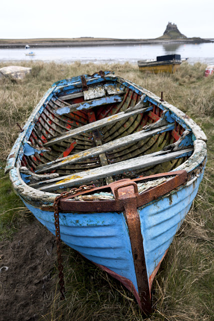 Colourful old boat on Holy Island, Northumberland by Martyn Ferry Photography