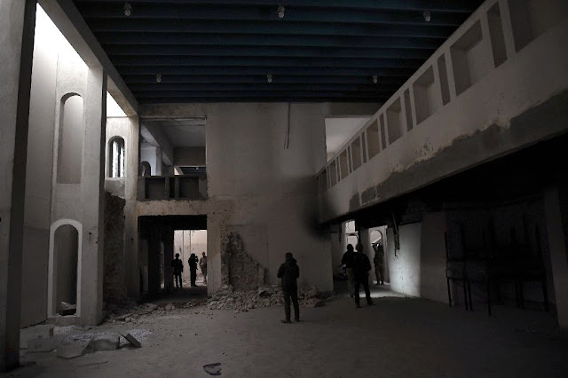 Priceless remains lie in ruins at Mosul museum