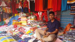 Korail Basti clothing vendor