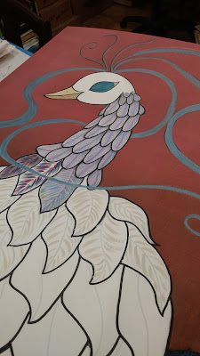 adding detail work to the white feathers