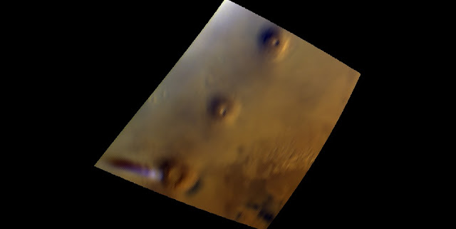 The visible and near-infrared mapping spectrometer, OMEGA, on ESA's Mars Express observed a curious cloud formation that appears regularly in the vicinity of the Arsia Mons volcano.  This water ice cloud, which arises as the volcano slope interacts with the air flow, can be seen as the white, elongated feature in the lower left part of the image, extending westward of the volcano and casting a shadow on the surface. The image was taken on 17 September 2018, from an altitude of 11 000 km. North is up. Credit: ESA/CNES/CNRS/IAS