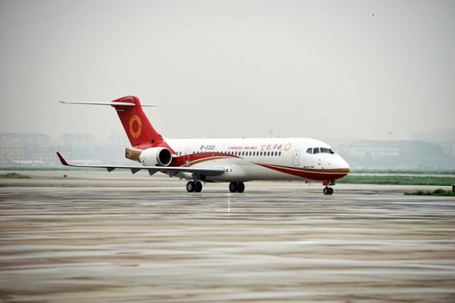 China's first domestic regional jet ARJ21-700 arrives at Shanghai Hongqiao Airport after making its first flight from Chengdu to Shanghai earlier this year. AFP
