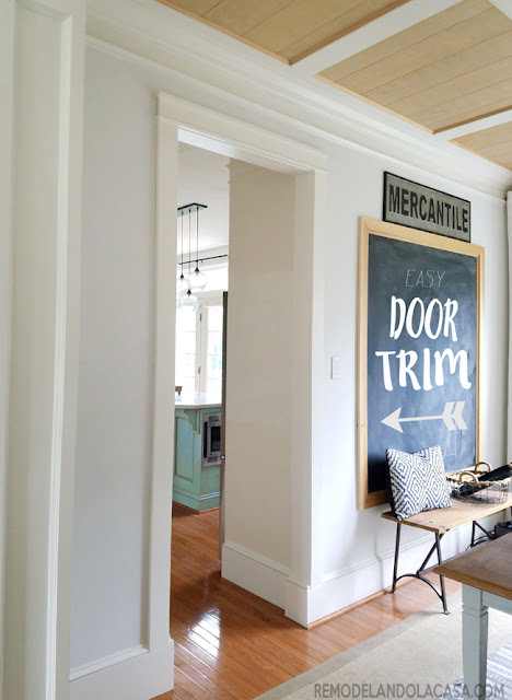 a small passage door gets trimmed - chalkboard on wall