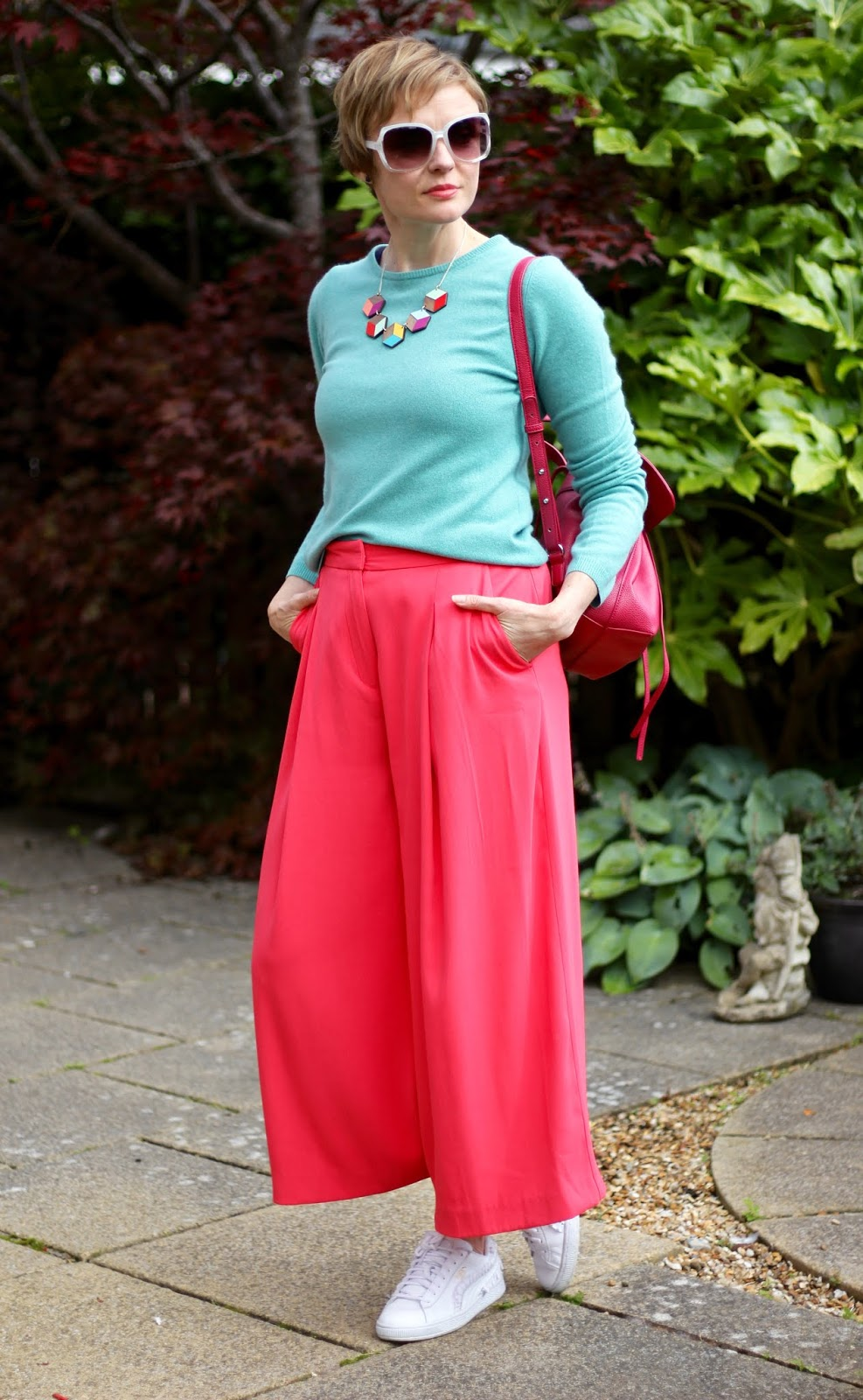Styling baggy neon pink culottes and an aqua cashmere knit | Fake Fabulous