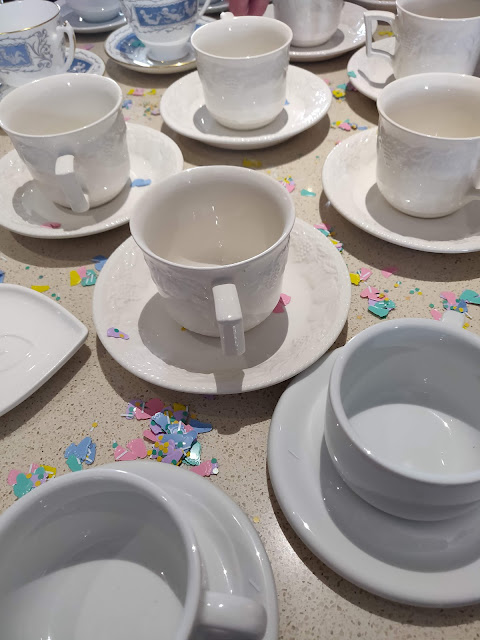 cups and saucers with baby shower confetti