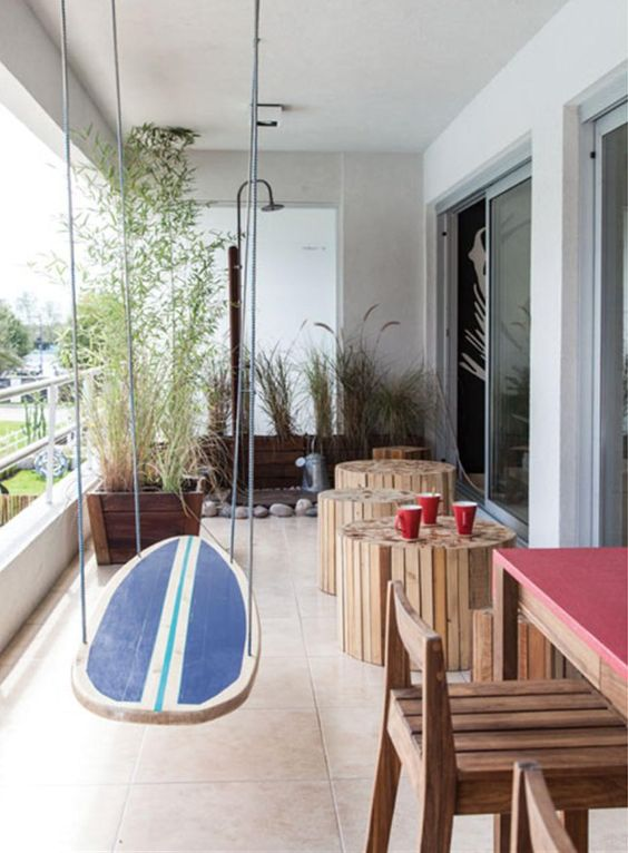 Wood surfboard floating table or swing in beachy room - found on Hello Lovely Studio