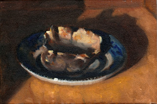 Oil painting of an oyster shell on a blue and white saucer.