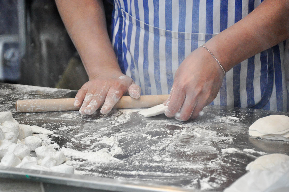 Rolling dumplings, Chinatown, London, England