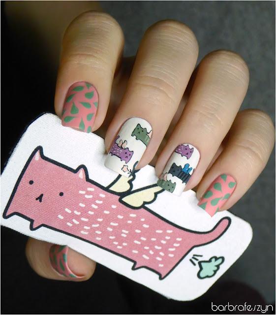 koty na paznokciach