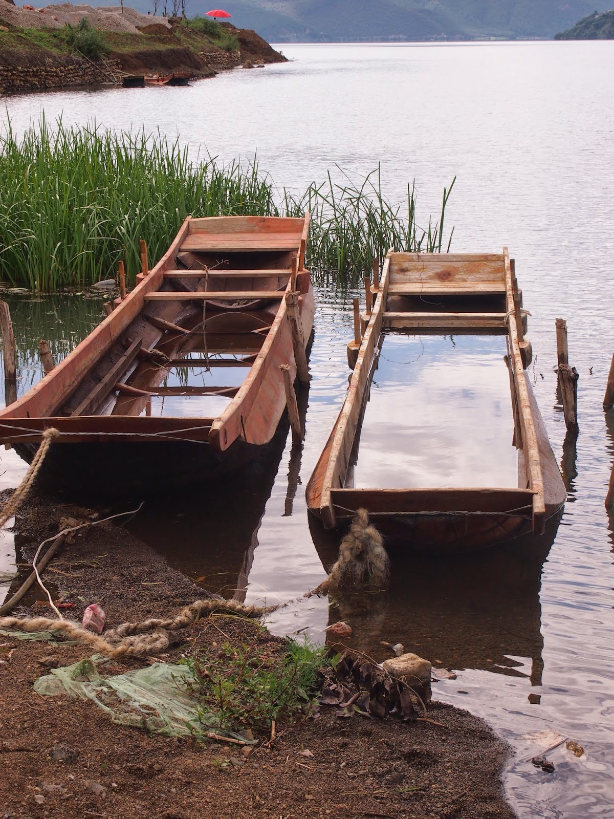 Broken boats filled with water on lugu Lake