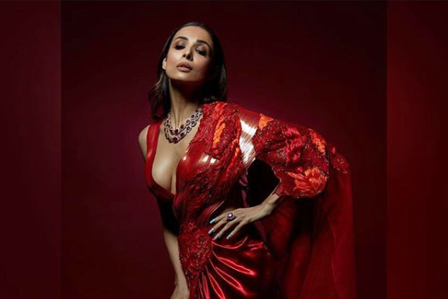 Hotness Overloaded Malaika Arora looked bold in a red saree