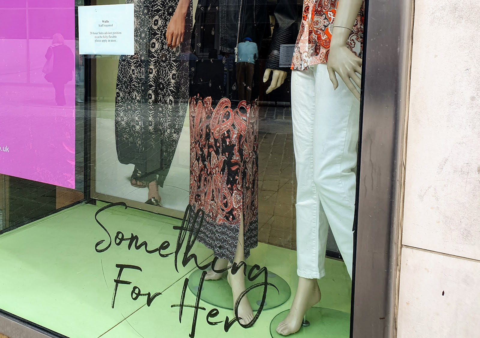 shop window with clothed mannequins and titled something-for-her.