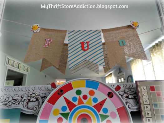 Fun banner and whimsical vintage toy mantel