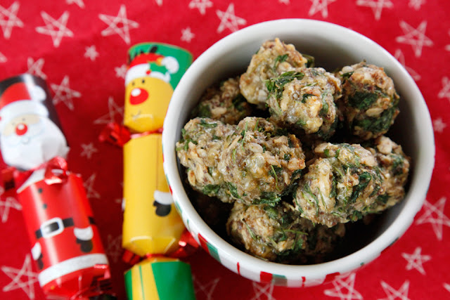 Homemade meatball dog treats in a Christmas bowl