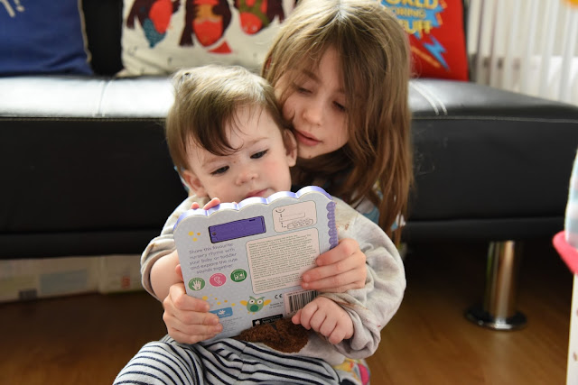 Reading with his sister
