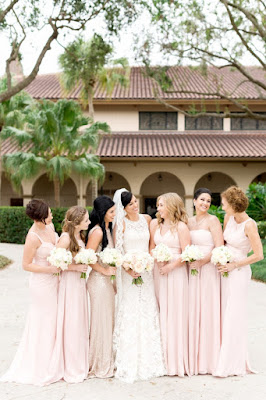 pink bridesmaids dresses with bride