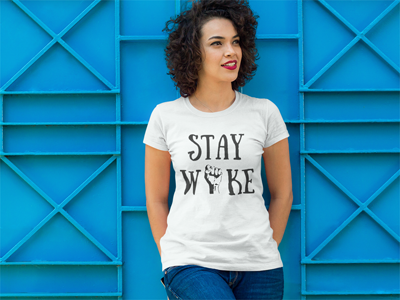 curly haired woman wearing white Stay Woke t-shirt by Audacity Tees | My Fabulous Boobies
