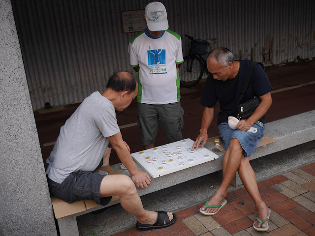 two men playing xiangqi in Sha Tin, Hong Kong