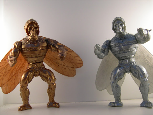 "Off ""Rejects of Eternia"" Bootleg Masters of the Universe Action Figure by Giant Japanese Monster, Bad! - Bronze & Silver Colorways"
