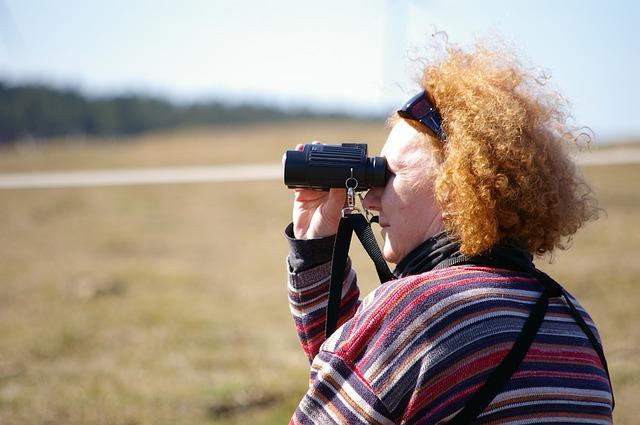 Older Woman Looking Through Binaculars