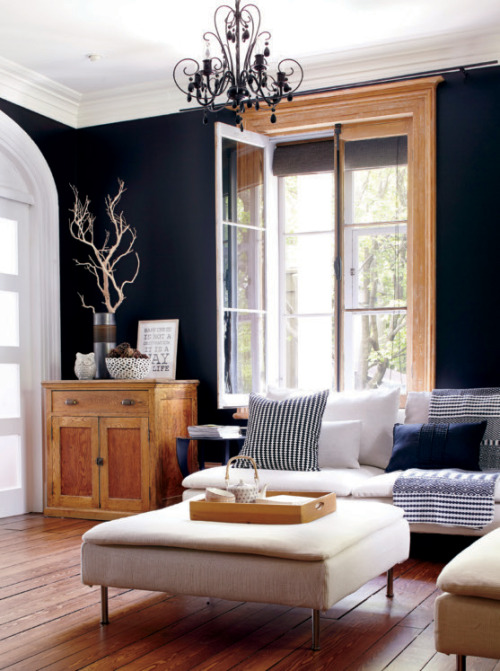 black wall. wooden furniture