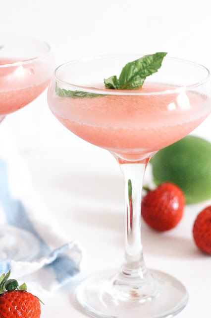 Frosé! The trendiest cocktail of the summer! This recipe combines fruity rosé, sweet strawberry and zesty lime in the most refreshing and beautiful summer drink!