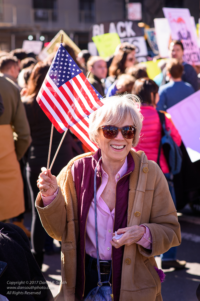 a photo of a beautiful lady protesting with flags in new york