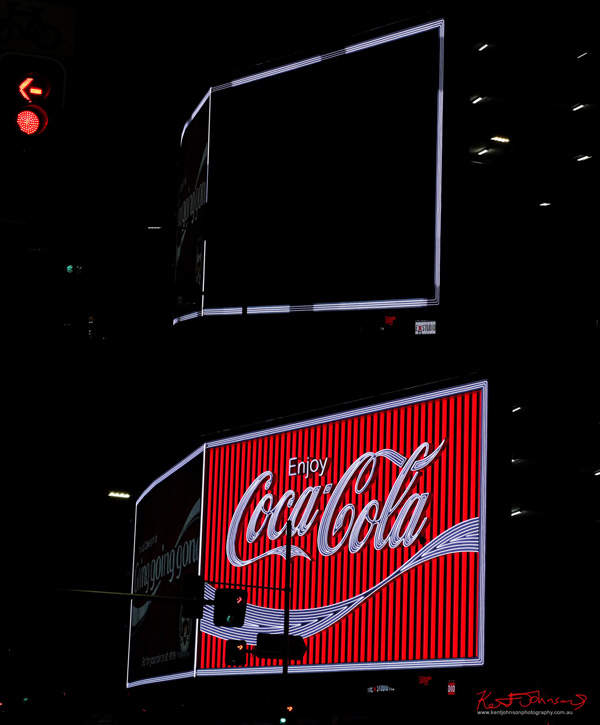 The newly restored Coca-Cola sign in Kings Cross Sydney lit up for the first time. Street Fashion Sydney by Kent Johnson.