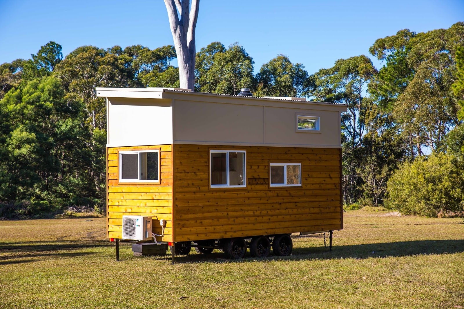 Tiny house town graduate series 6000dls by designer eco homes for Eco house builders
