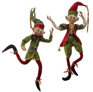 Large posable elf figures in red and green