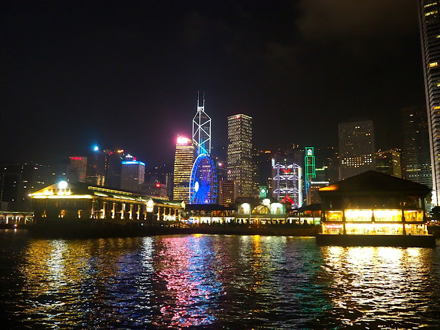 View of Central Piers and skyscrapers at night, from Star Ferry boat, Hong Kong