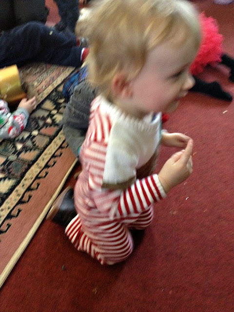 toddler kneeling with finger out to say shhh