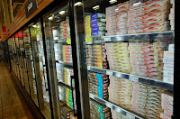Hydrofluorocarbons, or HFCs, help cool grocery refrigerator cases. They're also a powerful climate pollutant that leak into the atmosphere. (Credit: Open Grid Scheduler/flickr) Click to Enlarge.
