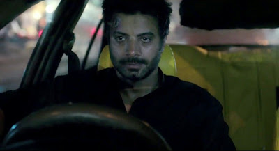 The kidnapper driving the car with the girl under his custody, Vineet Kumar, in Ugly, Directed by Anurag Kashyap