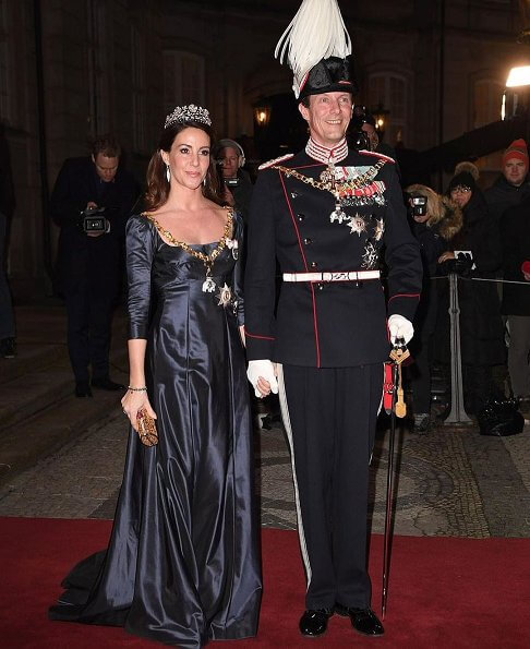 Crown Prince Frederik, Prince Joachim, Princess Marie and Princess Benedikte. Crown Princess Mary wore Birgit Hallstein gown