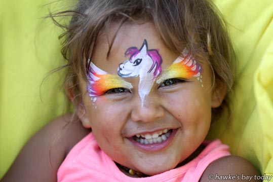 Shaelah Hemara, 3, Waipukurau, face-painted Pegasus - Horse of the Year in the City Showcase, Civic Square, Hastings, the first event of the annual Horse of the Year. photograph